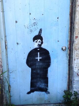 St Michaels Indian Residential School 2015 -  Boy on Door Graffiti