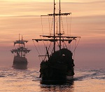 Old Sailing Ships Sailing into Sun - Shutter Stock