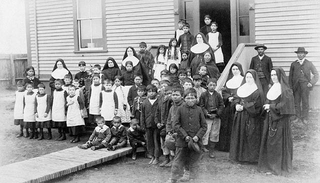 Indian residential school students and nuns, location unknown, ca 1890-1